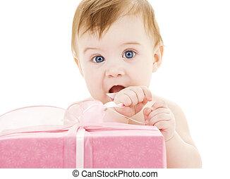baby boy with big gift box