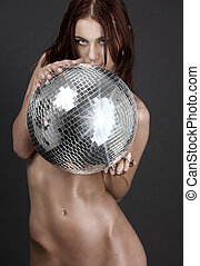 beautiful naked woman with disco ball
