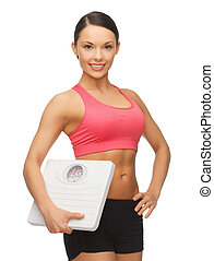 woman with scale - picture of beautiful sporty woman with ...
