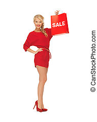 beautiful woman in red dress with shopping bag