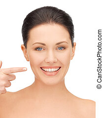 beautiful woman pointing to teeth
