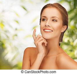 beautiful woman with moisturizing creme drop
