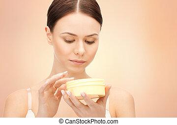 beautiful woman with moisturizing creme