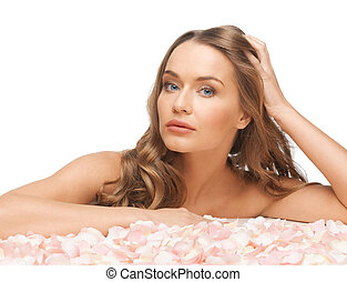beautiful woman with rose petals - picture of beautiful...