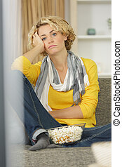 picture of beautiful young woman relaxing at home watching tv