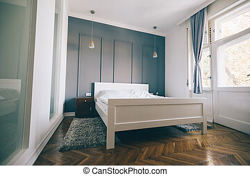 Picture of bedroom in soft light colors and comfortable bed