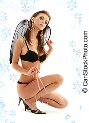 black lingerie angel on high heels with snowflakes