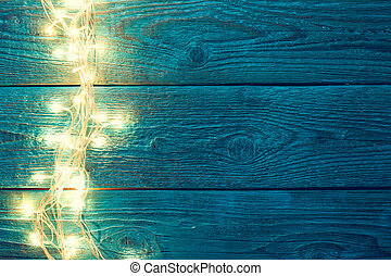 Picture of blue wooden table with burning garland on side