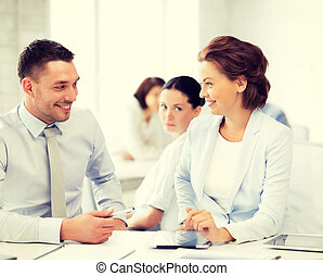 usiness colleagues talking in office