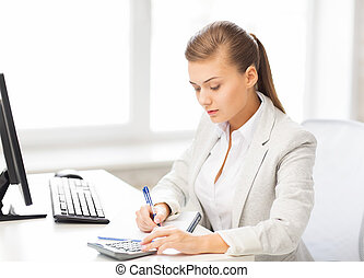 businesswoman with notebook and calculator - picture of...