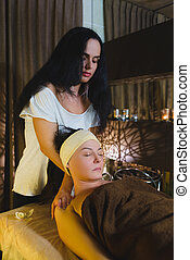 picture of calm beautiful woman in massage salon