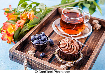 Picture of dessert with blueberries, tea