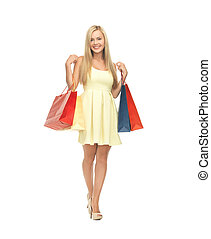woman with shopping bags in dress and high heels