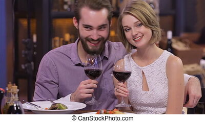 Picture of engaged couple with wine glasses