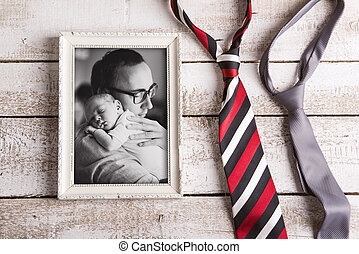 Picture of father holding baby son. Fathers day. Studio shot.