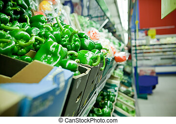 Picture of fresh bell peppers and other vegetables in supermarket