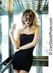 girl posing in elevator with cup of coffee - picture of girl...