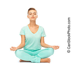 girl sitting in lotus position and meditating - picture of...