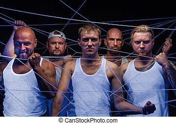 Picture of group of men tangled in white threads in ultraviolet