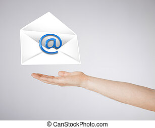 hand holding envelope with email sign