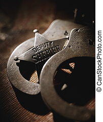 Handcuffs and badge - Picture of Handcuffs and badge