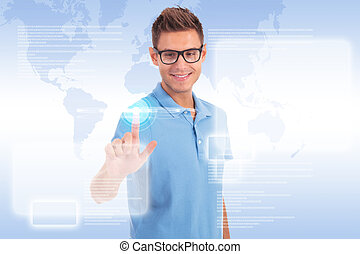 casual young man working with touch screen