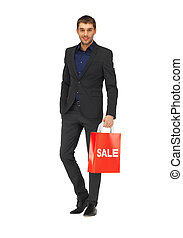handsome man in suit with shopping bags - picture of ...