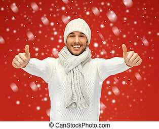 handsome man in warm sweater with snow