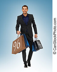 man with shopping bags - picture of handsome man with ...