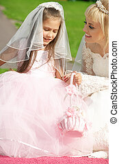 happy bride and little bridesmaid