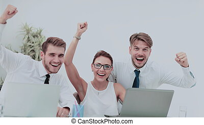 Picture of happy business team celebrating victory in office...