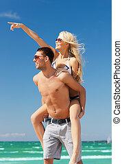 couple having fun on the beach