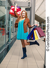 picture of happy girl with shopping bags