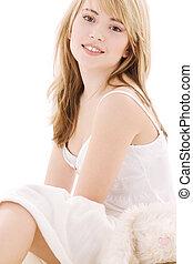 happy teenage girl in bed
