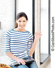 happy teenage girl waving a greeting