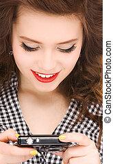 happy teenage girl with digital camera