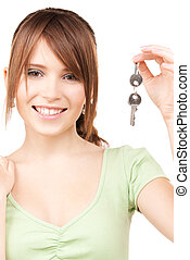 picture of happy teenage girl with keys
