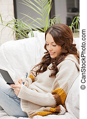 happy woman with small notepad - picture of happy woman with...