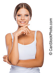 Picture of health and vitality. Smiling young woman holding hand on chin and looking at camera while standing against white background