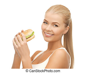 woman eating junk food - picture of healthy woman eating ...
