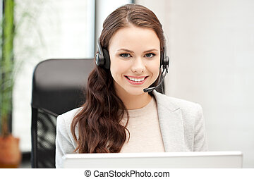 helpline operator with laptop computer - picture of helpline...