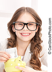 little girl with piggy bank and money - picture of little...
