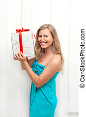 woman in dress with present