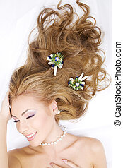 lovely woman with christmas decorations in hair - picture of...