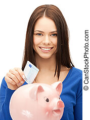 lovely woman with piggy bank and money - picture of lovely ...