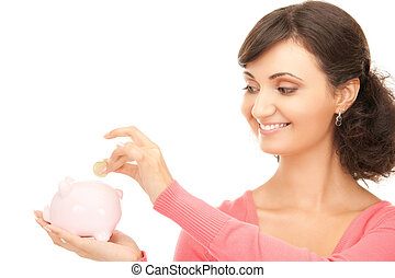lovely woman with piggy bank and money - picture of lovely...