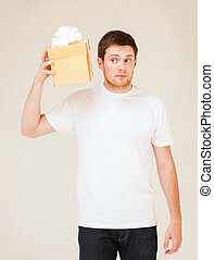 man in white t-shirt with gift box