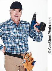 picture of mature carpenter holding drill