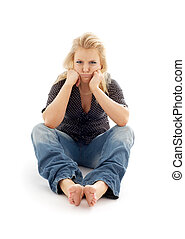 offended girl sitting on the floor