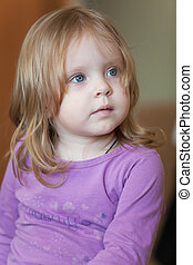Picture of pensive small girl with blue eyes and blond hair